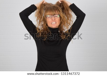 angry young adult woman or expression of anger and anger #1311467372