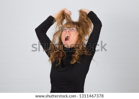 angry young adult woman or expression of anger and anger #1311467378
