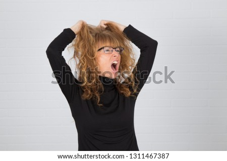 angry young adult woman or expression of anger and anger #1311467387
