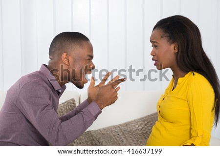 Angry Young African Man Screaming At Woman