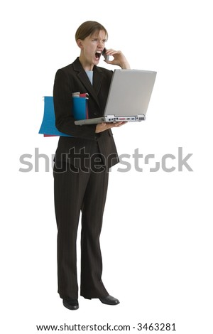 Angry, young business woman with computer and folders - yelling into a cell phone. Image is isolated on a white background.