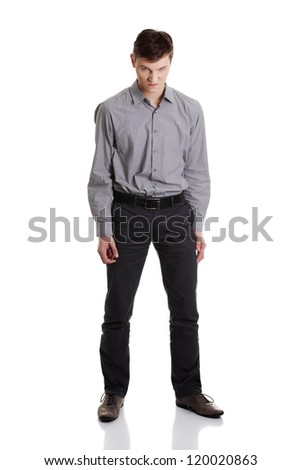 Angry young businessman , isolated on white background