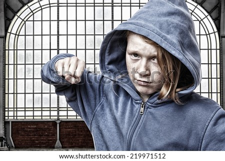 Angry young girl is ready to fight