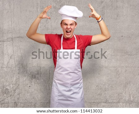 Angry Young Man Raising His Hand, Indoor - stock photo