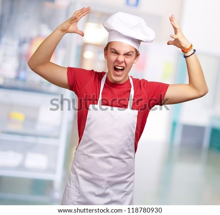 Angry Young Man Raising His Hand, Indoor