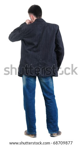 angry young man. Rear view. isolated over white.