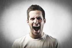Angry young man screaming
