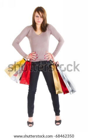 angry young woman standing with shopping bags over white background