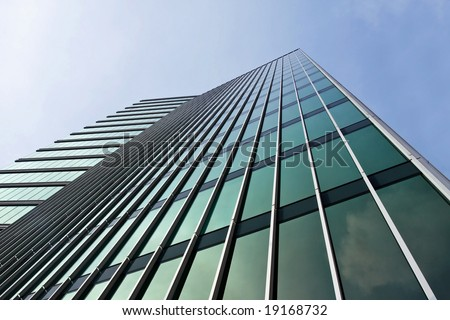 Angular Green Glass Tower Against Blue Sky