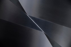Angular metal panels. Steel sheets resembling abstract modern architecture exterior or interior detail. Industrial background in hi-tech style. Polygonal or polyhedron geometric pattern. Sharp corners