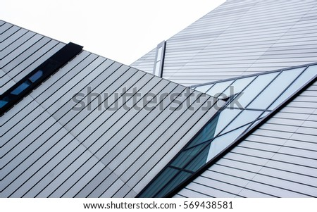 angular sharp edge architectural design with glass and aluminum panels as an abstract background #569438581