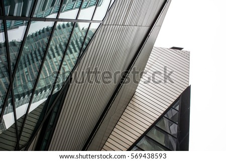 angular sharp edge architectural design with glass and aluminum panels as an abstract background #569438593