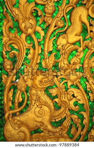 Animal carvings on the doors of the temple in the novel in a Thai temple.