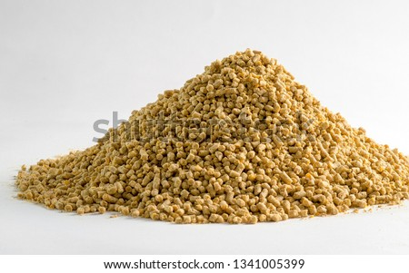 Animal feed for chicken and pig closeup with white background. Photo for feeding business and pet