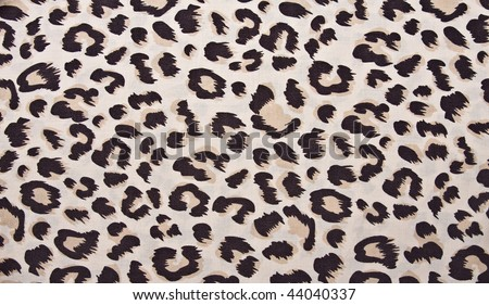 Animal print, leopard pattern fabric background in brown colors.