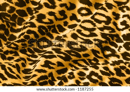 Animal print on fabric. Leopard, tiger.  Look at my gallery for more backgrounds and textures