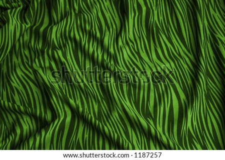 Animal print on fabric. Pattern like a zebra, green and black  Look at my gallery for more backgrounds and textures