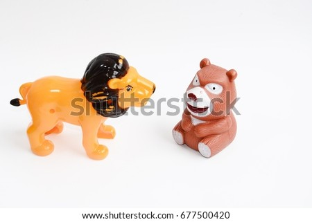 animal toys lion and bear on white background