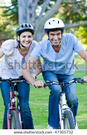 Animated couple riding a bike in a park