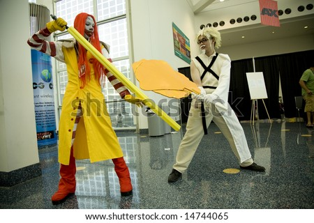 Anime Expo 2008, Los Angeles Convention Center, July 4th, 2008:  Anime fans portraying stylized versions of Ronald McDonald and Colonel Sanders in a battle.