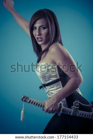 Stock Photo Anime stylized brunette with short hair holding a katana sword with two hands