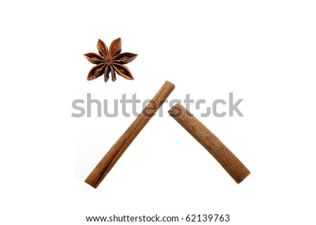 Anise stars and cinnamon sticks isolated on white arranged as a house and star. Christmas (Bethlehem) symbol