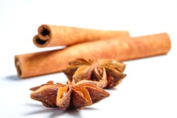 Anise stars, Badian and cinnamon on a white background, space for text,lat lay.