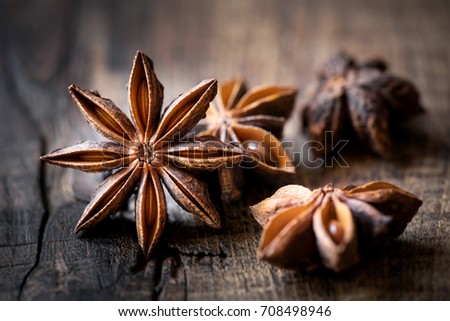 Anise stars closeup against dark rustic wooden background