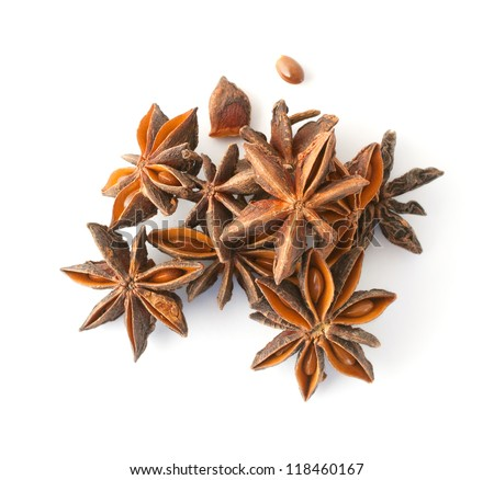 Anise stars in a heap on white background, top view.