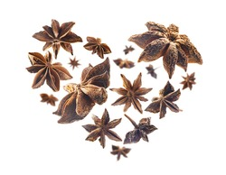 Anise stars in the shape of a heart on a white background
