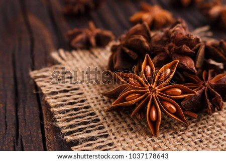 anise stars on a dark rustic background #1037178643
