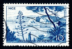 Ankara, Turkey - 3 June 2021: A France postage stamp shows Nice urban area located in the French Riviera, on the south east coast of France on the Mediterranean Sea. Circa 1955...
