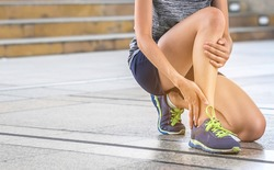 Ankle twist sprain accident in sport exercise running jogging.