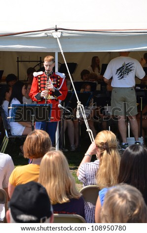 ANN ARBOR, MI - MAY 19: Staff Sergeant Jonathon Troy, clarinetist with the United States Marine Band, performs at Picnic Pops in his hometown of Ann Arbor, Michigan May 19, 2012.