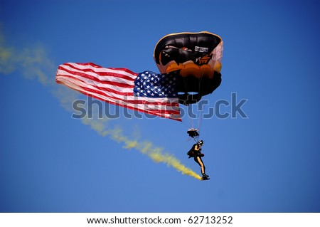 ANN ARBOR, MI - OCT 09: 101st Airborne Division Parachute Demonstration Team member parachuting above Michigan Stadium before the Michigan vs. Michigan State football game Oct 9, 2010 in Ann Arbor, MI.