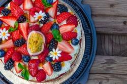 Anna Pavlova French dessert with blackberries,blueberries, passion fruit, raspberries, strawberries. Meringue cake. Vegetarian cake. Low fat dessert. Dietary dessert.