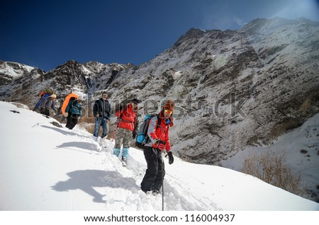 ANNAPURNA, NEPAL - FEBRUARY 5 : mountaineers trekking to top of Annapurna base camp in Annapurna, Nepal February 5, 2012. Annapurna trail is well known for its trekking activities.