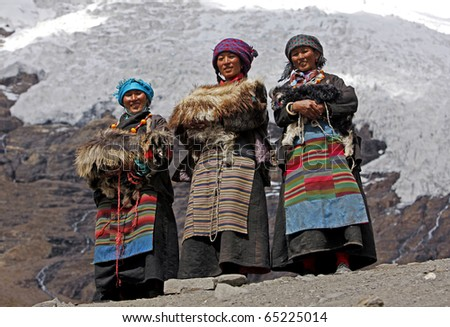 ANNAPURNA, NEPAL - OCTOBER 02: Three Tibetan women in traditional dresses, on October 02, 2010 in Nepal