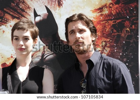 Anne Hathaway and Christian Bale at the Christopher Nolan Hand and Footprint Ceremony, Chinese Theater, Hollywood, CA 07-07-12