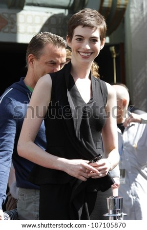 Anne Hathaway at the Christopher Nolan Hand and Footprint Ceremony, Chinese Theater, Hollywood, CA 07-07-12