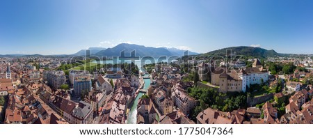 Annecy city center panoramic aerial view with the old town, castle, Thiou river and mountains surrounding the lake, beautiful summer vacation tourism destination in France, Europe Photo stock ©