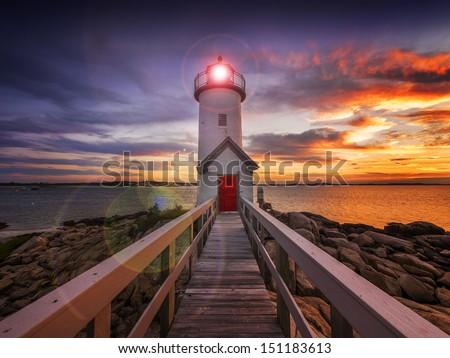 Annisquam lighthouse at sunset off the coast of Gloucester, MA. USA