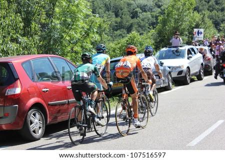 ANNONAY, FRANCE - JUL 13: J.C. Peraud, E. Martinez, C. Gauthier, R. Kiserlovski, D. Millar in stage 12 of Le Tour de France 2012. David Millar wins the race on July 13, 2012 in Annonay Ardeche, France