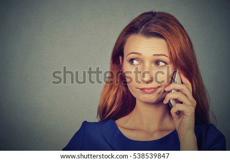 Annoyed upset woman talking on mobile phone