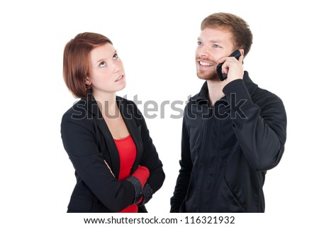 Annoyed woman waiting for the phone