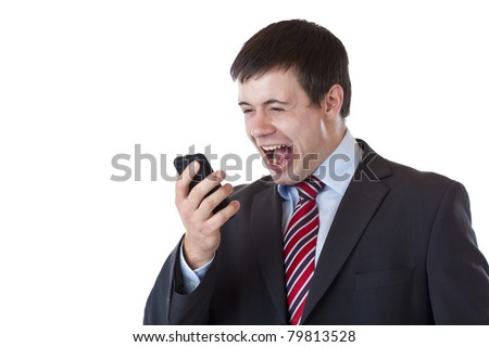 Annoyed young businessman shouts aloud in cell phone.Isolated on white background.