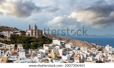 Ano Siros town cityscape, Syros island, Greece, aerial drone view. The Church of Resurrection uphill, calm sea and cloudy blue sky background. Foto stock ©