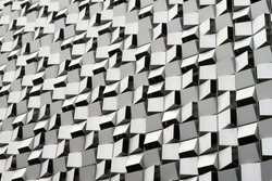 Anodized aluminium panels forming geometric cheese grater pattern on exterior of multi storey car park