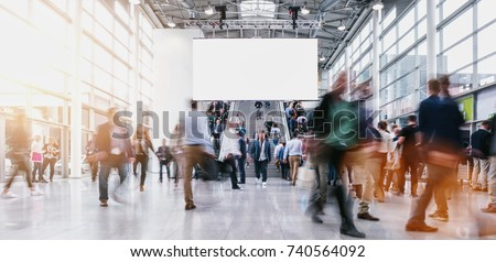 anonymous blurred people at a tradeshow #740564092