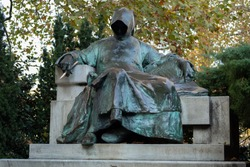 Anonymous bronze statue of a writer with a pen  at Vajdahunyad park
